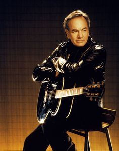 Neil Diamond.  Diamond was inducted into the Songwriters Hall of Fame in 1984 and into the Rock and Roll Hall of Fame in 2011.  He was born in Brooklyn, New York, to a Jewish family descended from Russian and Polish immigrants.