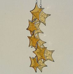 Gold Star Cascade Suncatcher, Stained Glass Suncatcher. £14.00, via Etsy.