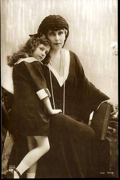 "Queen Marie of Romania with her daughter Princess Maria, known as ""Mignon""."