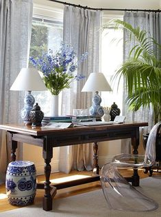 Stacie Flinner A pair of Ralph Lauren blue and white Chinese porcelain lamps, a blue and white Chinese garden stool, and a pair of pierced black ginger jars add great style to this work space. I too h