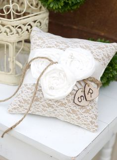 Burlap with Lace Rustic Ring Bearer Pillow and Chiffon Flowers with Personalized Hearts. $37.99, via Etsy.