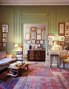"""Pierre Le-Tan's sitting room and entry hall with works by Warhol, Giacometti and his youngest son, Edward .""""I'd love to live in a place with very few things that are just impeccable,"""" he says, wistfully. But, ultimately, he knows he could never part with all the treasures he's collected over half a century. François Coquerel"""