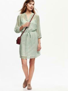 Cute shirt dress,  looks like it could be dressed up or down.