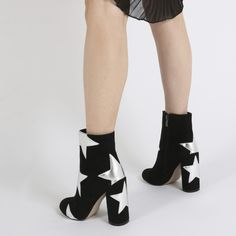 Starry eyed suprise with this next one. Oversized cut out star print heeled ankle boots. Featuring a rounded toe and cylindrical block chunky heel and side zip. These are a great addition to your everyday boot collection. Pair with fishnet tights and an oversized tee dress for a casj on trend look. Heel Height: 4.4\