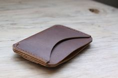 A man only needs to carry a few things each day, otherwise hell just feel bogged down and bummed out about life in general. Enter the Simple Wallet, which aims to relinquish your everyday carrying woes. It features two pockets and a quick cash strap on the back to slip your notes or