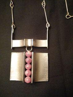 Matti Hyvärinen, vintage modernist sterling silver necklace with five pink/salmon agate stones, 1972. #Finland   FinlandJewelry.com
