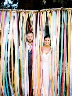 Buy spools of ribbon in variations of two to three inches, and make sure they are in shades of your wedding colors. Tie seven- to eight-foot strands to a branch, and suspend it from the ceiling or out(Diy Photo Backdrop) Whimsical Wedding, Trendy Wedding, Wedding Colors, Wedding Themes, Chic Wedding, Summer Wedding, Wedding Events, Ribbon Backdrop, Diy Backdrop