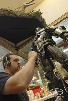 Stan Winston Studio/Legacy Effects key artist Trevor L. Hensley paints the Mark III maquette for IRON MAN.