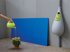 Bas van der Veer's Raindrop ... is a rain barrel with a watering can that fills up automatically when it rains.