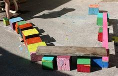 "Painted reclaimed wooden blocks with wooden planks ("",)"