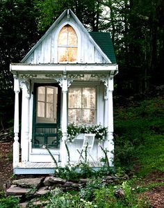Whimsical tiny house.  This would be a perfect play house for Etta when she's bigger.