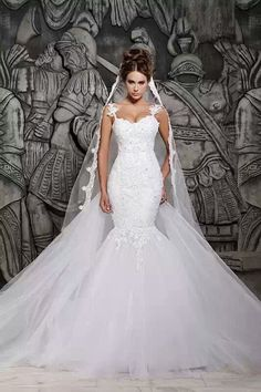 I like the body fit and shoulder strap style luxury train lace mermaid wedding dress by RoyalWeddingStore, $1000.00
