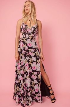 Featuring a slight v-neck and thigh high slit, our Kat Silk Maxi shows just the right amount of skin. Details include criss-cross adjustable spaghetti straps at back.
