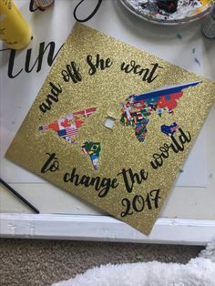 and off she went to change the world decorated graduation cap