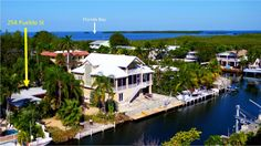 Cute as can be ground-level conch house in Indian Waterways with 60' of canalfront and Dade County Pine ceilings! Open floor plan with 3 Bed/2 Bath make this a comfortable home for entertaining and easy living. Sliding glass doors lead from the living room and florida/sun room to a lushly landscaped, large backyard and deep water canal for boating with great bay and ocean access.