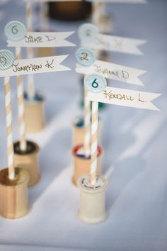 escort cards displayed with vintage spools, photo by Anita Martin Photography http://ruffledblog.com/emerald-olympic-valley-wedding #escortcards #weddingideas #vintage