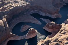"""A bleached """"bathtub ring"""" is visible on the rocky banks of Lake Powell on March 28, 2015 in Lake Powell, Utah.  As severe drought grips parts of the Western United States, a below average flow of water is expected to enter Lake Powell and Lake Mead, the two biggest reservoirs of the Colorado River Basin. Lake Powell is currently at 45 percent of capacity and is at risk of seeing its surface elevation fall below 1,075 feet above sea level by September, which would be the lowest level on…"""