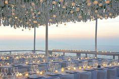 """Roof top reception - took 24 hours to construct an open air white pergola structure featuring hundreds of flowing jasmine – which was covering the entire roof top. In between these – to give some amazing & natural light, we had hundreds of glass candle holders made in white painted glass ( which we hung in between the white floral to give some additional warmth to all the white."""""""