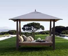 I want this to use as an outdoor bedroom! Covered double chaise lounge from les jardins (au bout du monde collection), sold by PatioWorld in California. Seen in an ad in Architectural Digest.  My only concern is that the canvas top would blow away in a sudden, unexpected wind storm.