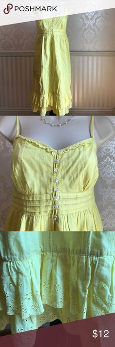 """NWT GAP Lemon Yellow Sundress NWT Gap sundress in lovely lemon yellow color. So cute and flattering for a hot summer day! Adjustable straps. Delicate eyelet trim at neckline and hem. Feminine double ruffles at hemline. White buttons on bodice. Fully lined. Bust is about 34,"""" length is approximately 39."""" 100% cotton. Size 10. GAP Dresses"""