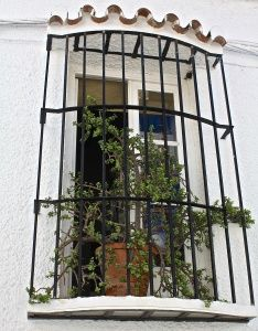 Plant pots in windows on the streets of Nerja