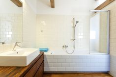 White Subway Tiled Shower And Bathtub