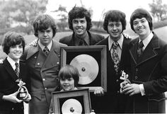 Just came across this fun old photo of my brothers posing with me and my first hit records. L-R from Front: Jimmy Osmond, Donny Osmon. Donny Osmond, Marie Osmond, Merrill Osmond, Osmond Family, The Osmonds, Family Boards, How To Draw Hair, Black And White Pictures, Personal Photo