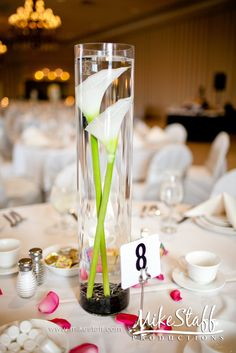 """A few tables with extra tall vases (18""""+) with purple calla lillies?"""