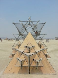 Front view of the Fractal Cult timber pods and Scaffolding at the Burning Man festival 2013