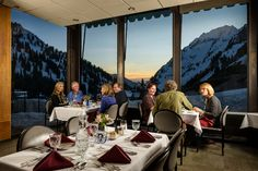 Twilight in the dining room at Alta Lodge during ski season.
