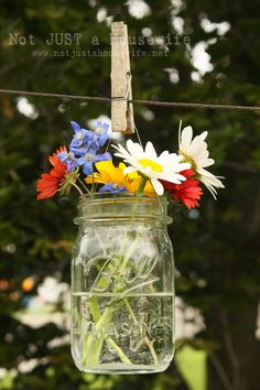 sweet flower display in a hanging jar - Not Just a Housewife