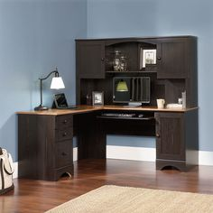 Sauder Office Furniture Harbor View L-Desk with Hutch and Reversible Storage, Cherry/Antique Black. Slide-out keyboard/mouse shelf. Two utility drawers. Storage area for a vertical CPU tower. Grommet hole for cord management. Corner Desk With Hutch, Secretary Desk With Hutch, L Shaped Corner Desk, Computer Desk With Hutch, Desk Hutch, Office Desk With Hutch, Computer Desks, Small Computer, Shopping