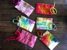 hand felted wool felt crayon roll assorted colours for boys & girls fits 10 Stockmar Block beeswax crayons. $22.00, via Etsy.