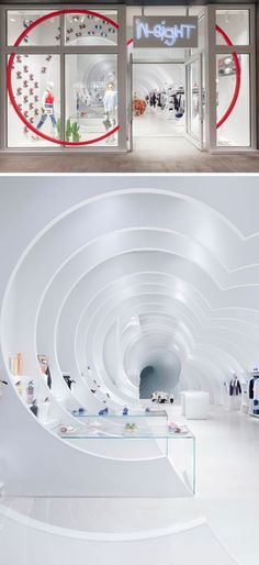This modern white retail store has 24 white panels that have been placed throughout the length of the store to create a tunnel-like atmosphere. #RetailDesign #RetailStore #InteriorDesign