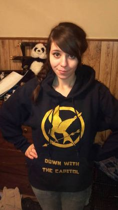 """Down with the capitol! Hunger games hoodie. Back says """"District 12 Tribute"""""""