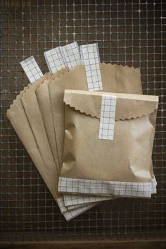 Kraft Bag Envelopes with Brown Grid Washi Tape 10 pieces  3 1/4 x 5 1/2. $5.50, via Etsy.