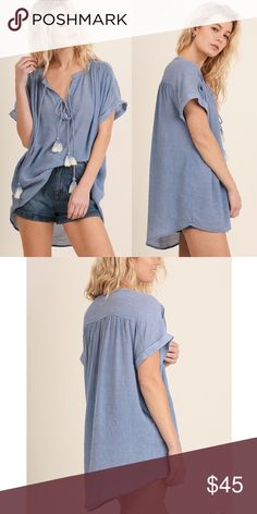 JAXTON tunic wth tassel detail - BLUE Comfy short sleeve tunic with cute tassel tie front detail. NO TRADE, PRICE FIRM Bellanblue Tops Blouses