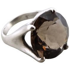 Mid-Century Modernist Sterling Silver and Smoky Quartz Cocktail Ring   From a unique collection of antique and modern miscellaneous jewelry at https://www.1stdibs.com/furniture/more-furniture-collectibles/miscellaneous-jewelry/