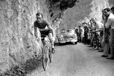 Cyclist Charly Gaul from Luxembourg races in the 1955 Tour.