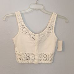 NWT Ivory cropped tank NWT purchased from Nordstrom. Never worn. Cropped and Perfect for summer! ☀️.  *NOT free people* Free People Tops Crop Tops