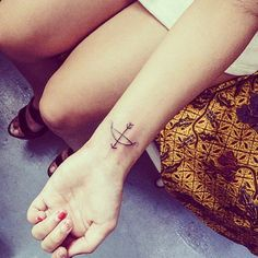 A cute bow and arrow tattoo to inspire your next ink.