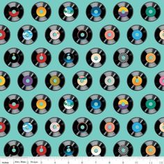 """Geekly Chic Records Teal Geekly Chic by Riley Black Designs. 100% quilt-quality cotton, 44-45"""" wide. Records on a teal background. Records measure approx. 1 3/8"""" x 1 3/8"""". #fabricbuffet #rileyblackdesigns #geeklychic #records #eighties #teal #fabric #quilts #sewing @Fabric Buffet"""