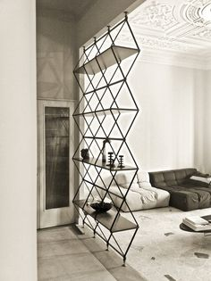 Unusual book case / partition - love this! Loving all the geometric shapes on trend right now x
