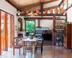 Some places in a home look really good if designed in rustic farmhouse style and kitchen is one of them. House With Balcony, Tropical Houses, Design Case, Decoration Table, Traditional Kitchen, Rustic Farmhouse, My Dream Home, Home Kitchens, Diy Home Decor