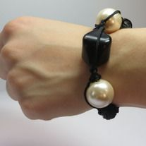 The simple black and white beads used in this piece are iconic. This is a statement piece for any occasion. http://deadwithtequila.storenvy.com/collections/738816-shamballa-bracelets/products/10405077-0113b-shamballa-bracelets