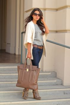 t-shirt & jeans with cream sweater. brown belt, shoes, & bag.