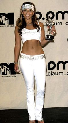 """Lopez rocked the NYC MTV Video Music Awards in a belly-baring ensemble (complete with head wrap!) from then-boyfriend Sean Combs' clothing line. """"When I got into music, I got a little more urban but with a bohemian rock-star quality,"""" she explains."""