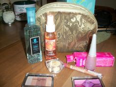 Make-up bag Lot  giving away FREE!!!  Free shipping  eye shadow, lip liner, nail polish, lip stick, perfume, etc... when the bid reaches 2000 credits I will add more and so on!!!