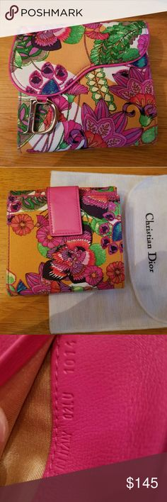 Christian dior fuchsia pink flower saddle wallet Christian Dior bifold wallet with fuchsia pink leather and floral print canvas.  PRICE IS FIRM. No offers on this listing.  100% Authentic. in excellent like-new condition. the only part has slight hint of use is the metal D charm with minor fine scratch when closely inspected, but not noticeable. (please see the pictures) comes in a dust bag. leather inside is not glossy feeling but out side has patent finish. originally paid over $450 when…