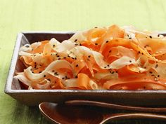 Use a vegetable peeler to cut ribbons of carrot and daikon radish for this lovely warm-weather salad.
